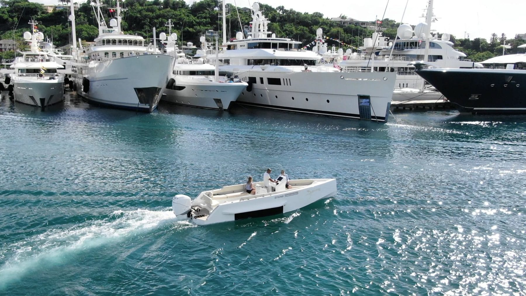 Iguana Original sailing with prestigious yachts around