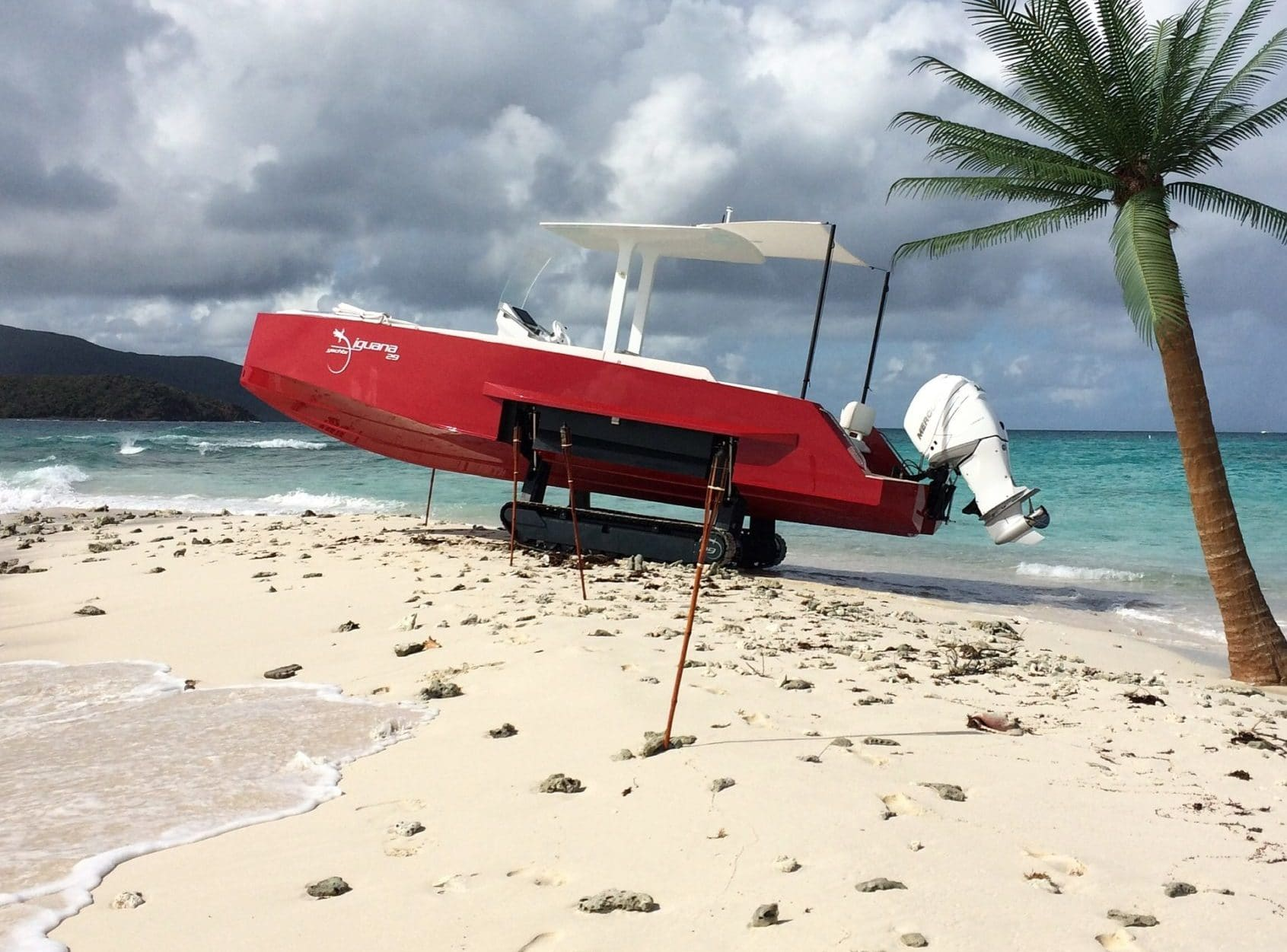 Amphibious boat with tracks on a private island