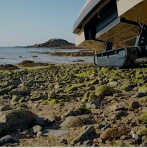 Amphibious vehicle on rocks