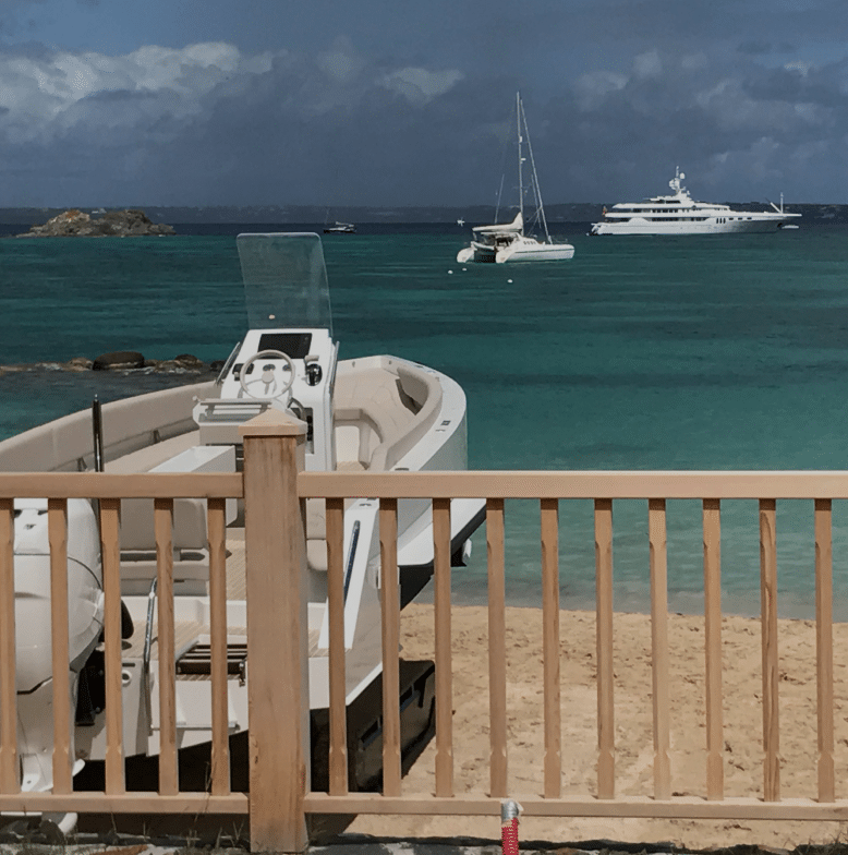 Beachfront hotel with an amphibious boat