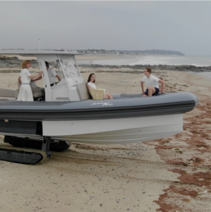 Amphibious boat with tracks on the beach